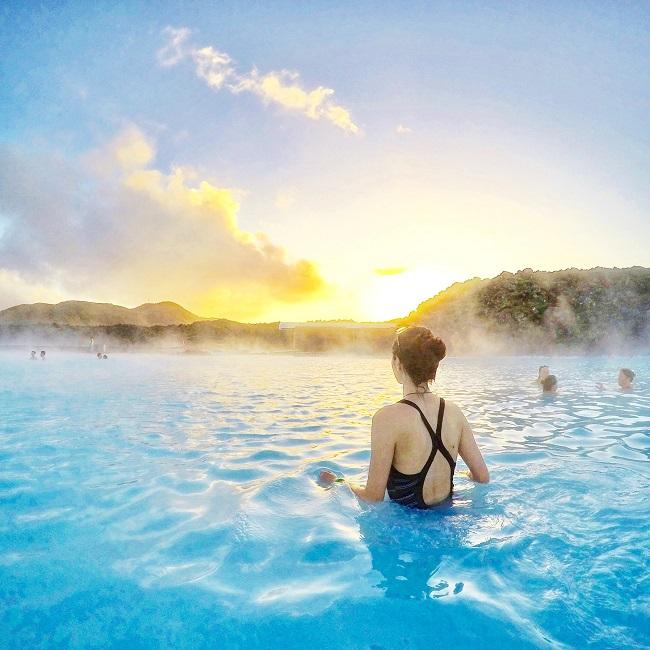 Girl at Blue Lagoon Iceland during sunset