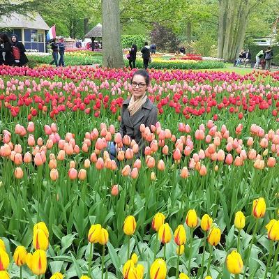 Girl surrounded by tulips at Keukenhof