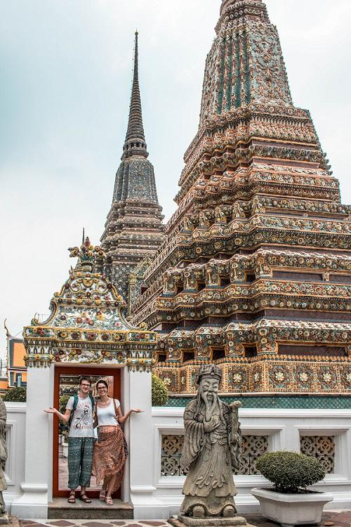 couple in front of Wat Pho Temple Bangkok, Thailand