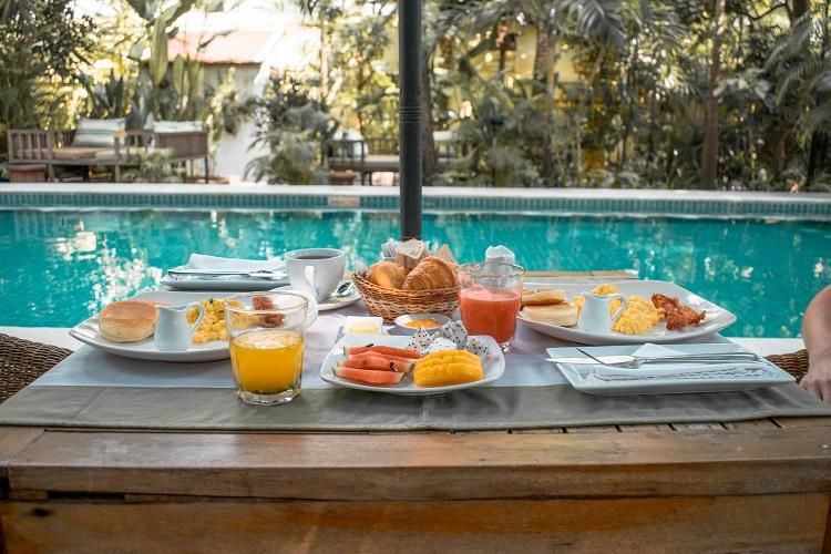 Breakfast by the pool at The Pavilion Hotel Phnom Penh