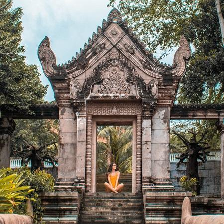 Girl at Independence Hotel Sihanoukville garden gate