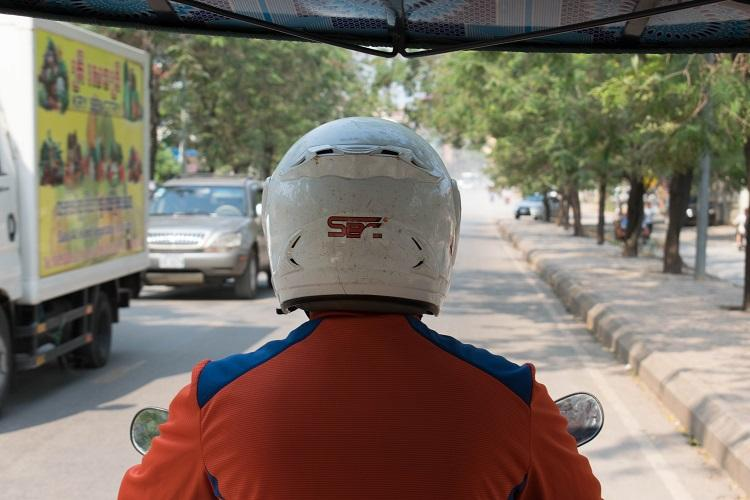 tuk tuk driver heading to Angkor Wat
