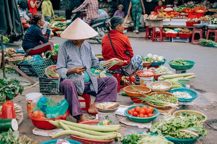 Hoi An woman selling vegetables in the market
