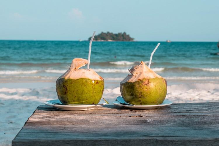Two coconuts on a table at Long Set Beach Koh Rong