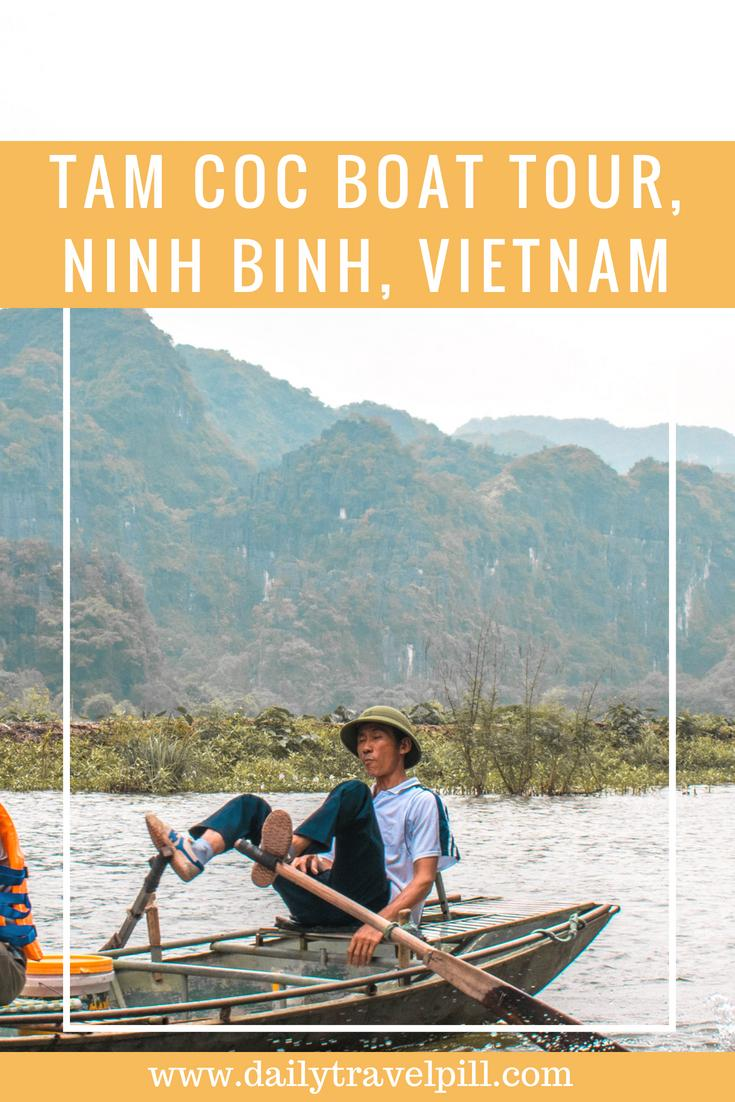 Vietnamese man rowing the boat with his feet in Tam Coc, Vietnam