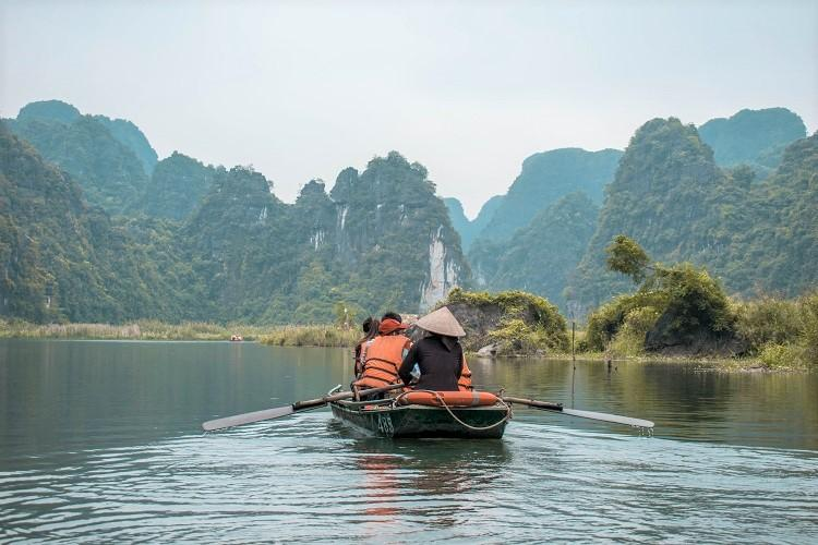 Trang An boat ride. Vietnamese rower in a boat