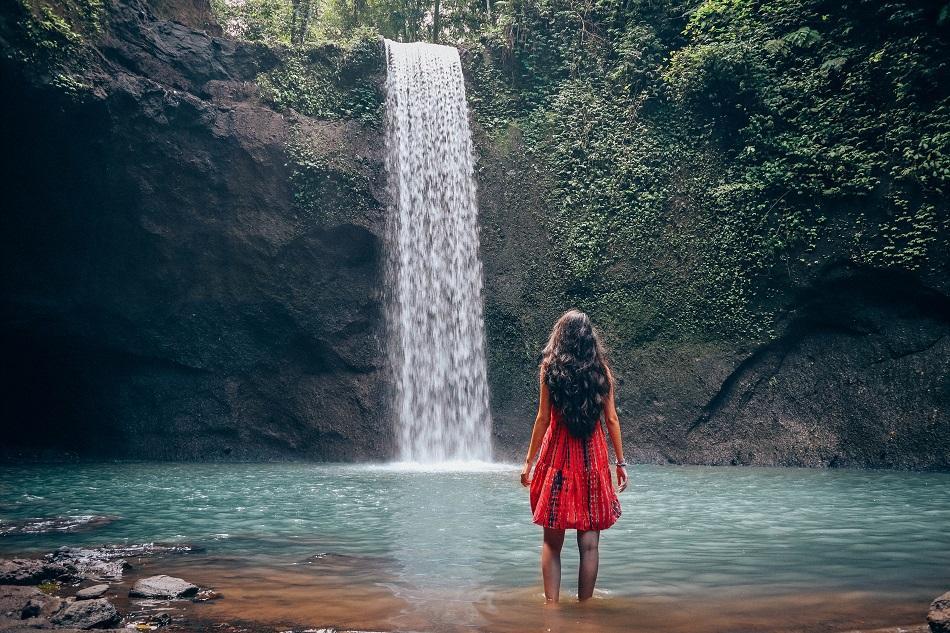 Girl at Tibumana Waterfall Bali, waterfall near Ubud