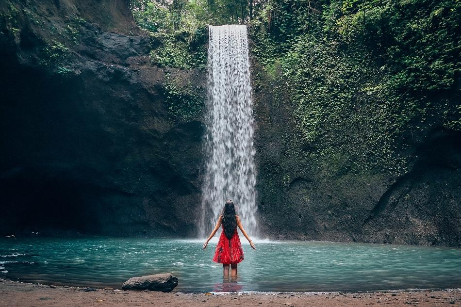 Girl at Tibumana Waterfall Bali