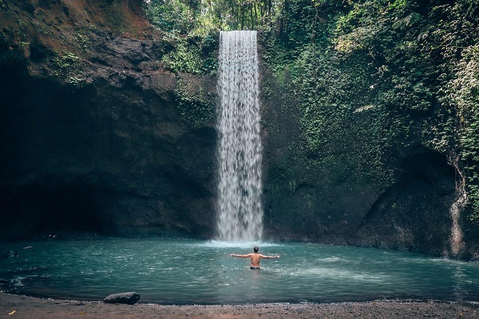 Swimming at Tibumana Waterfall Bali