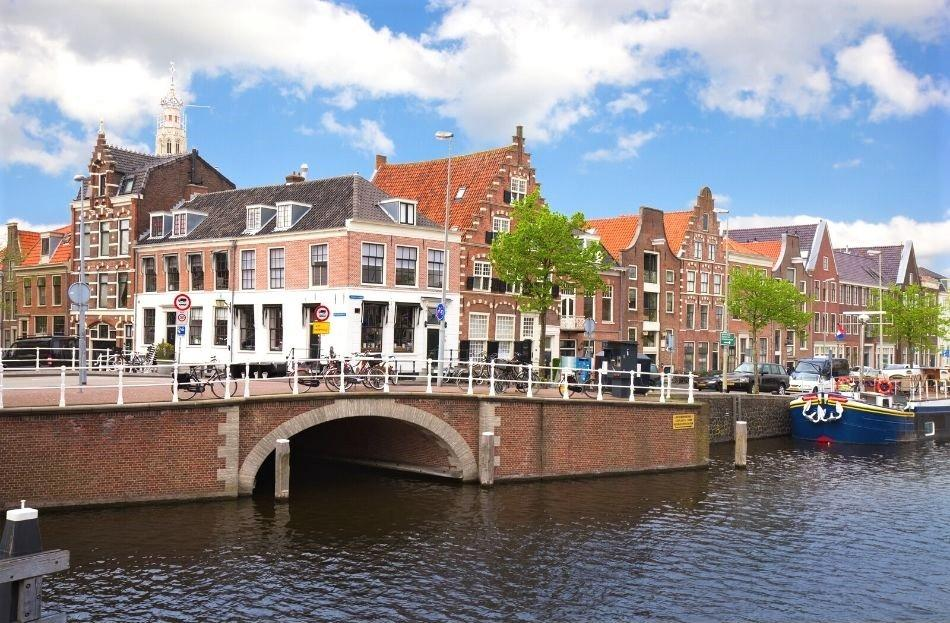 Dutch houses near a canal with a bridge in Haarlem, Netherlands