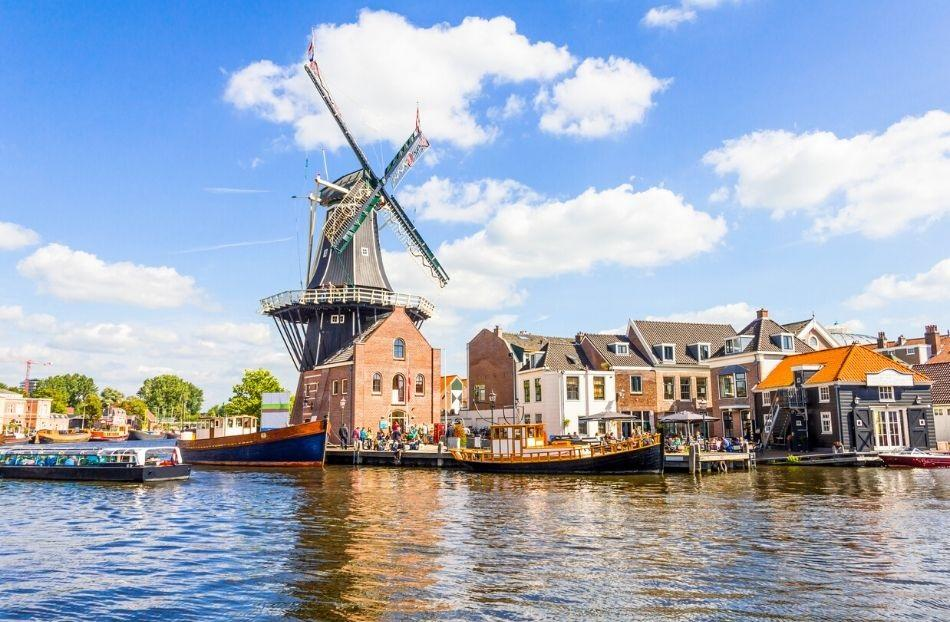 Haarlem windmill near canal river