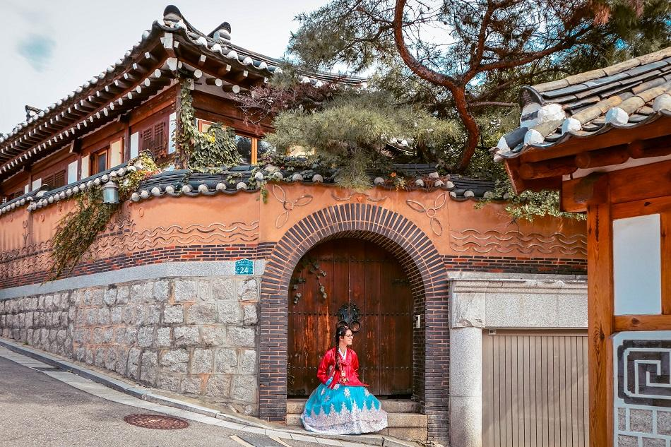 Foreign girl wearing a hanbok at Bukchon Hanok Village