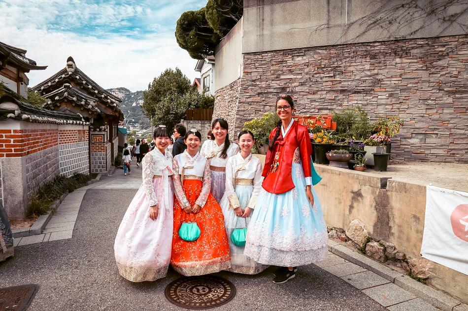 Foreign girl and Korean girls wearing a hanbok at Bukchon Hanok Village