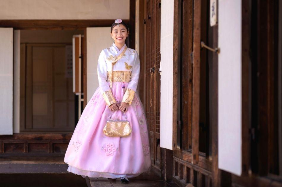 korean girl dressed in pink hanbok