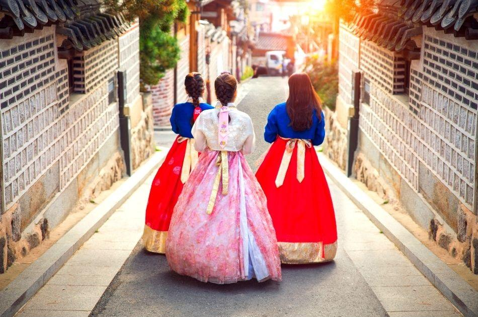 Korean girls in hanbok walking around Bukchon Hanok Village in Seoul