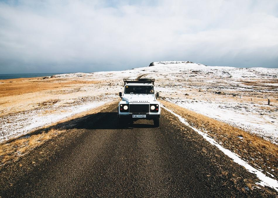 Car on the road in Iceland in winter