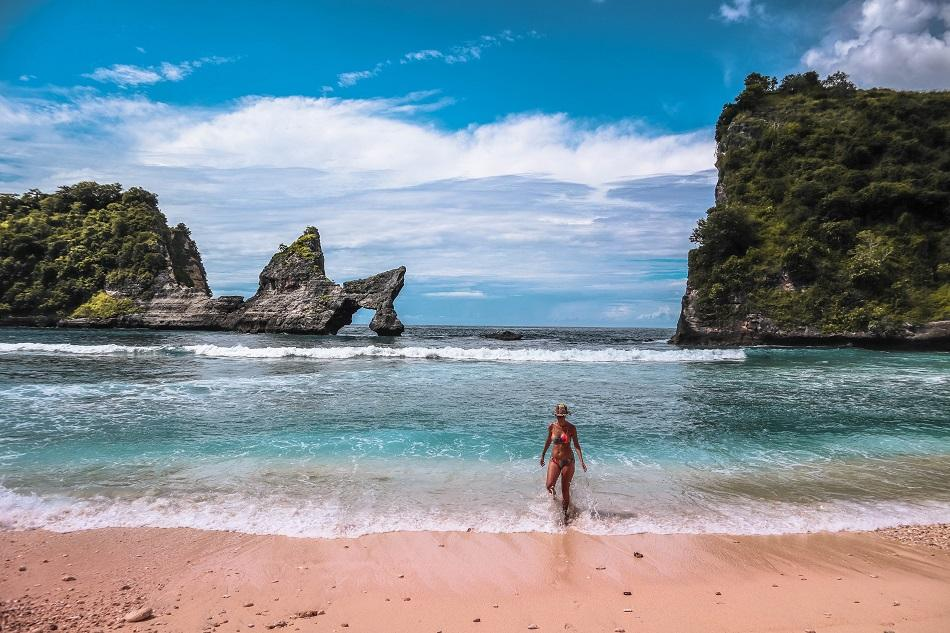 Girl on the beach at Atuh Beach, Nusa Penida