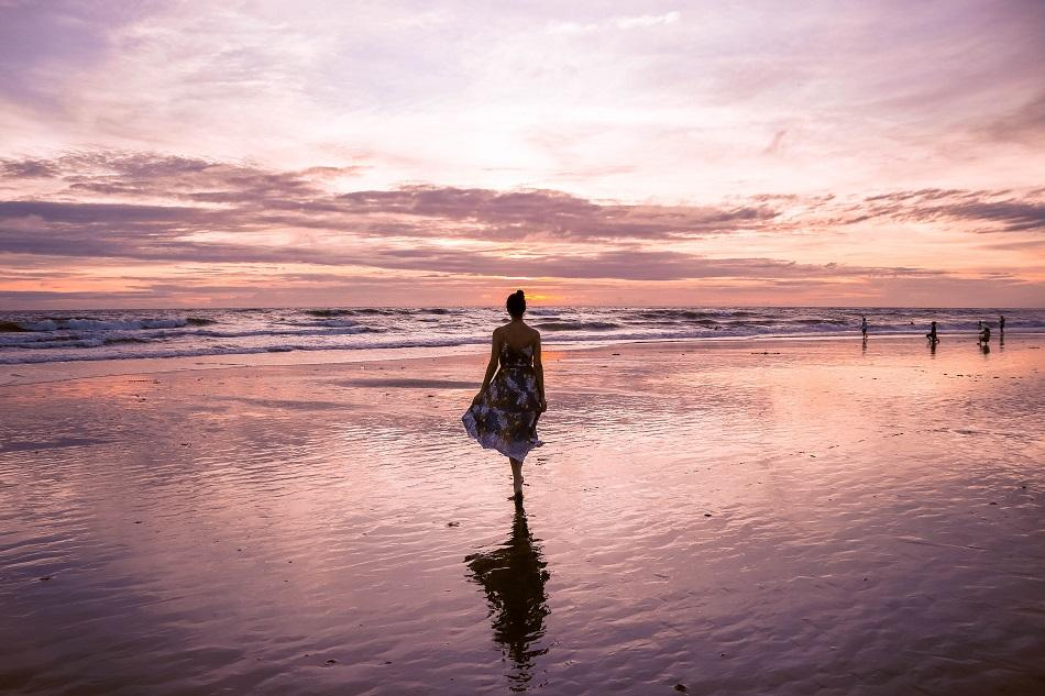 Girl on the beach at sunset in Bali