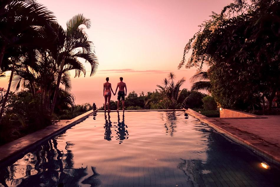 Couple in infinity pool at The Hamsa Resort Bali