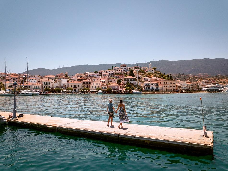 Couple walking on Poros Island, Greece