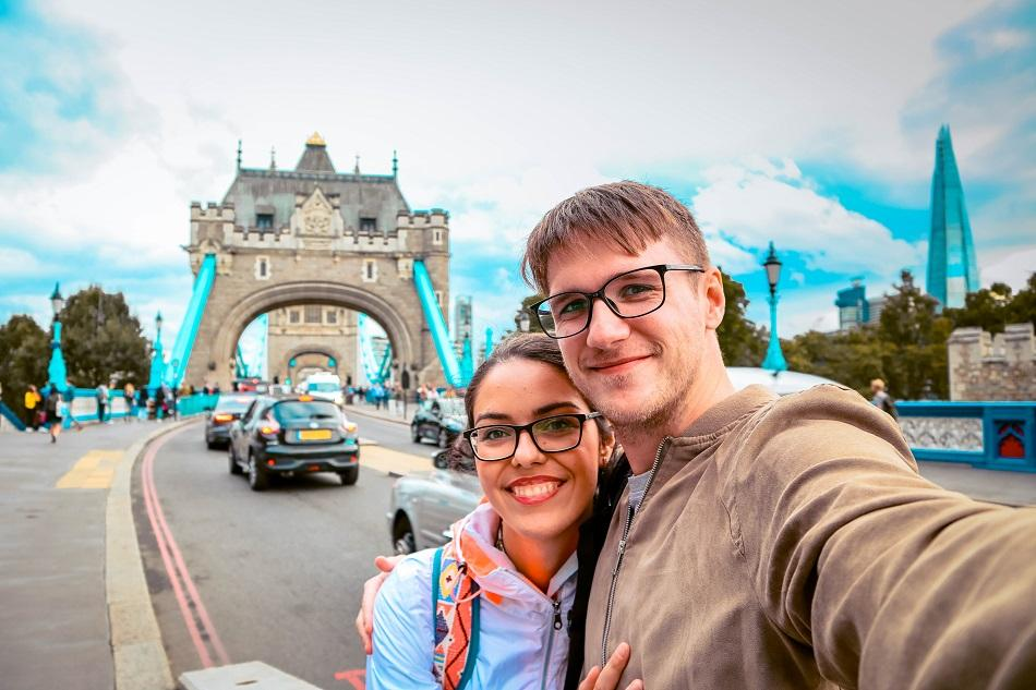Couple in front of Tower Bridge, London