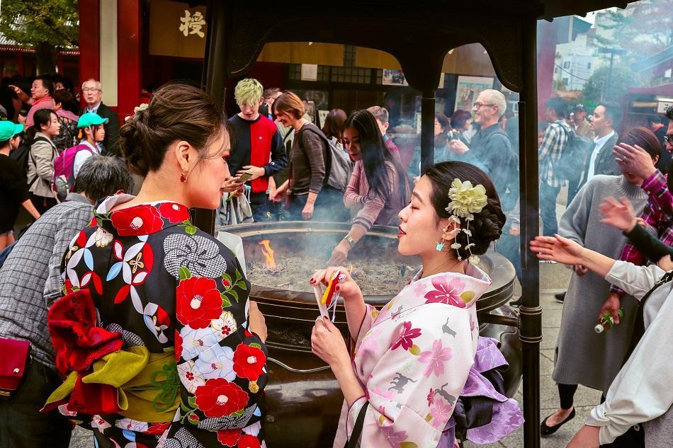 Japanese girls wearing a kimono in Tokyo at Senso-ji Temple
