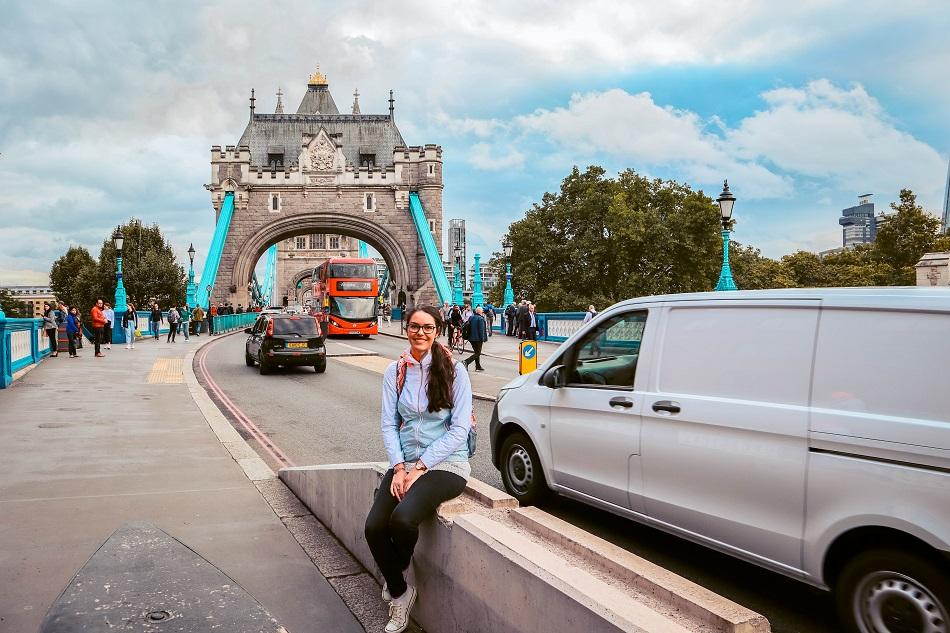 Girl in front of Tower Bridge, London