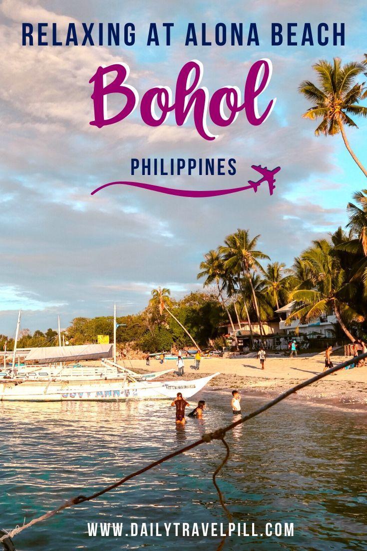 Alona Beach Bohol at sunset - palm trees and boats