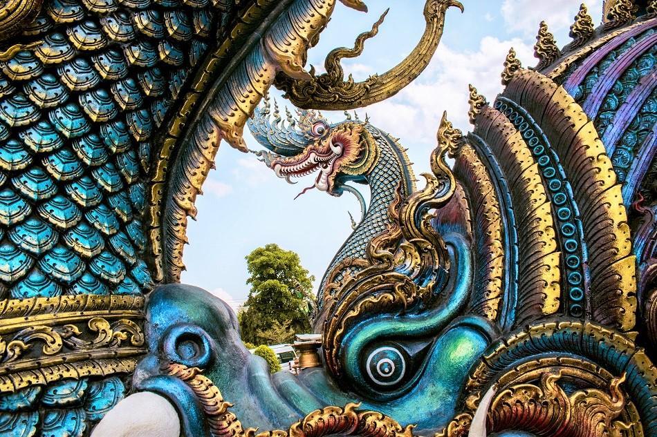 Naga serpents at Blue Temple Chiang Rai, also known as Wat Rong Seua Ten