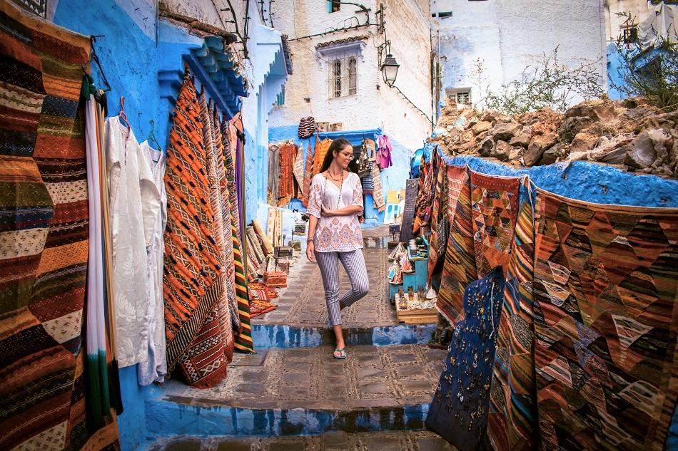 Chefchaouen bazaar, local colorful carpets
