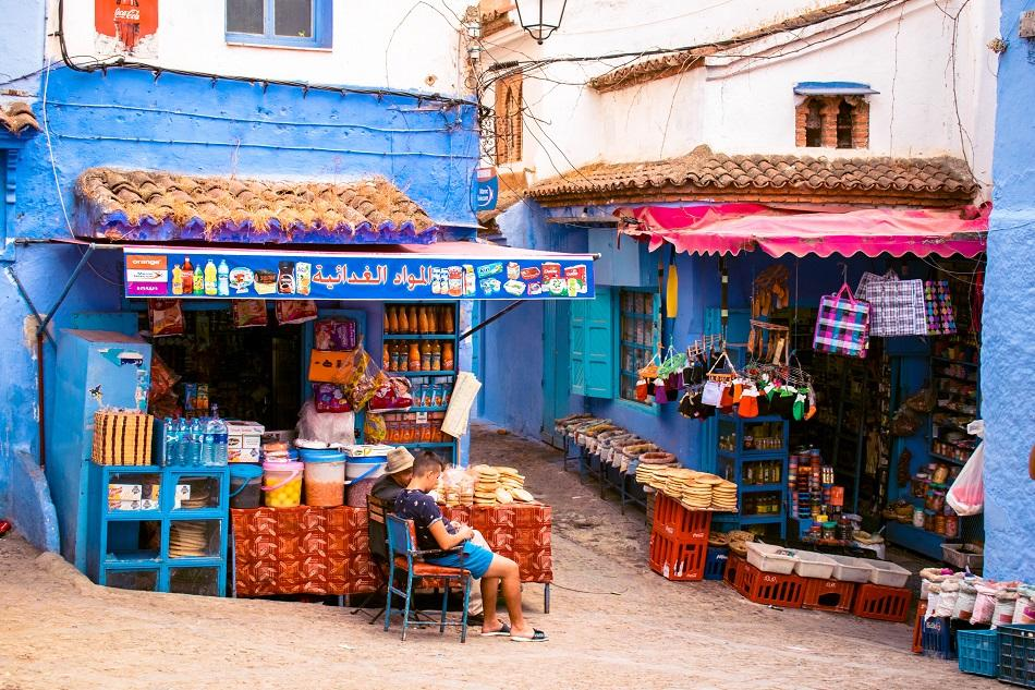 Street with local shops in Chefchaouen Morocco