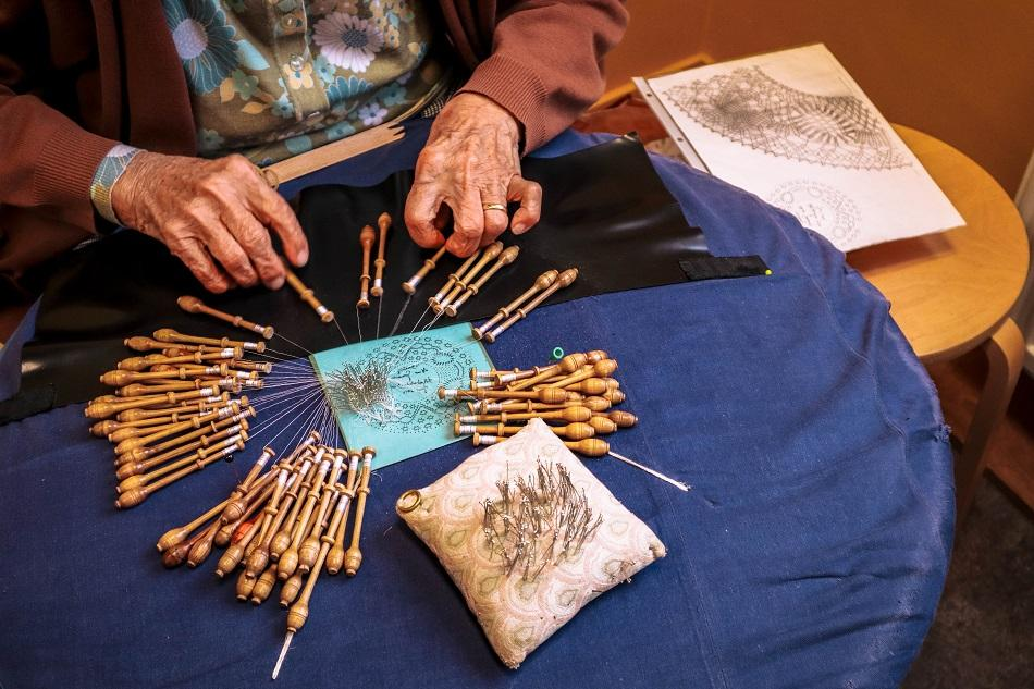Lady making hand made lace in Bruges