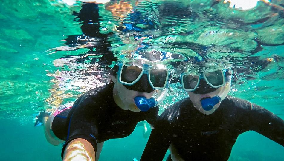 Aurelia Teslaru and Dan Moldovan snorkeling at Apo Island, Philippines
