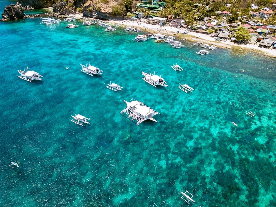 Drone view of boats at Apo Island, Philippines
