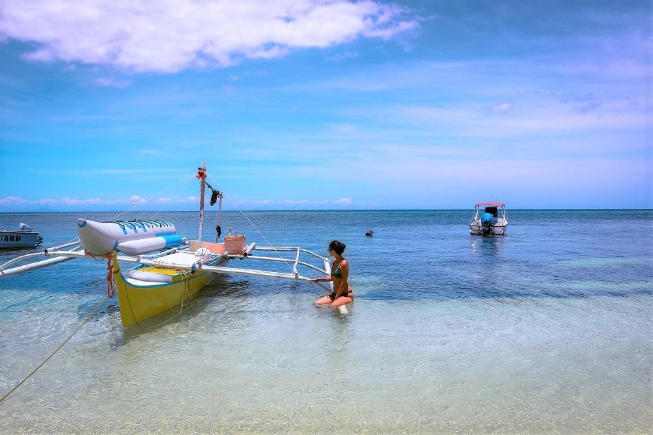girls on boat at Paliton Beach Siquijor