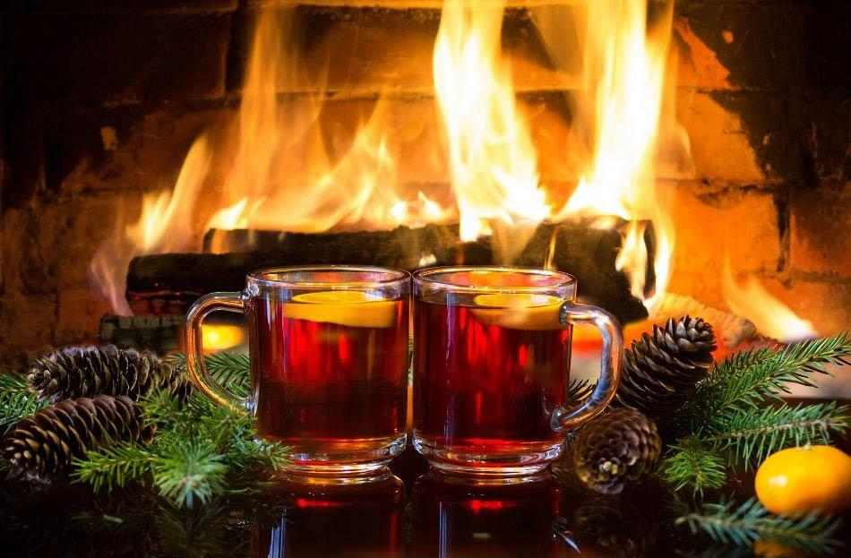 Glogi drink in front of fireplace in Lapland, Finland