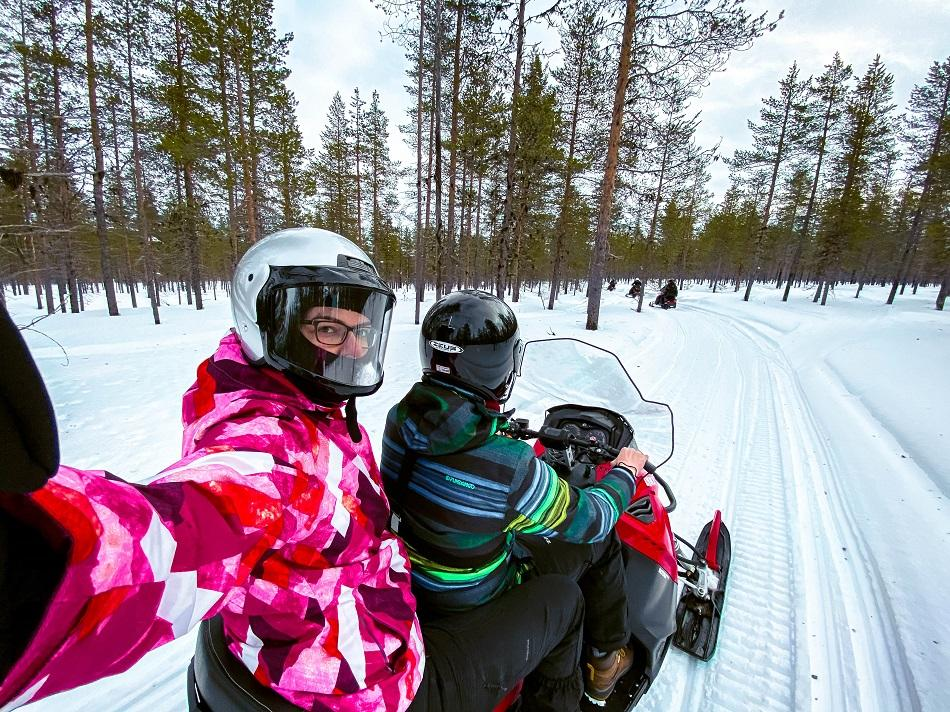 Aurelia Teslaru and Dan Moldovan snowmobiling in Lapland at Kakslauttanen Arctic Resort