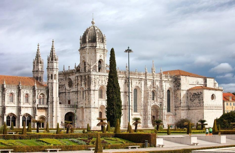 Exterior of Jeronimos Monastery on a cloudy day