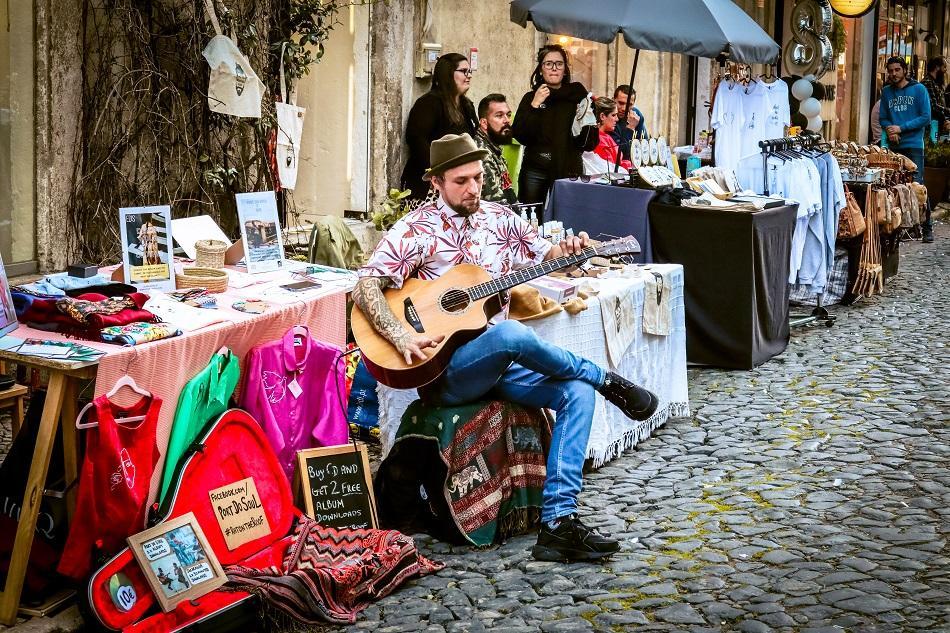 Lx Factory Lisbon artist singing at guitar