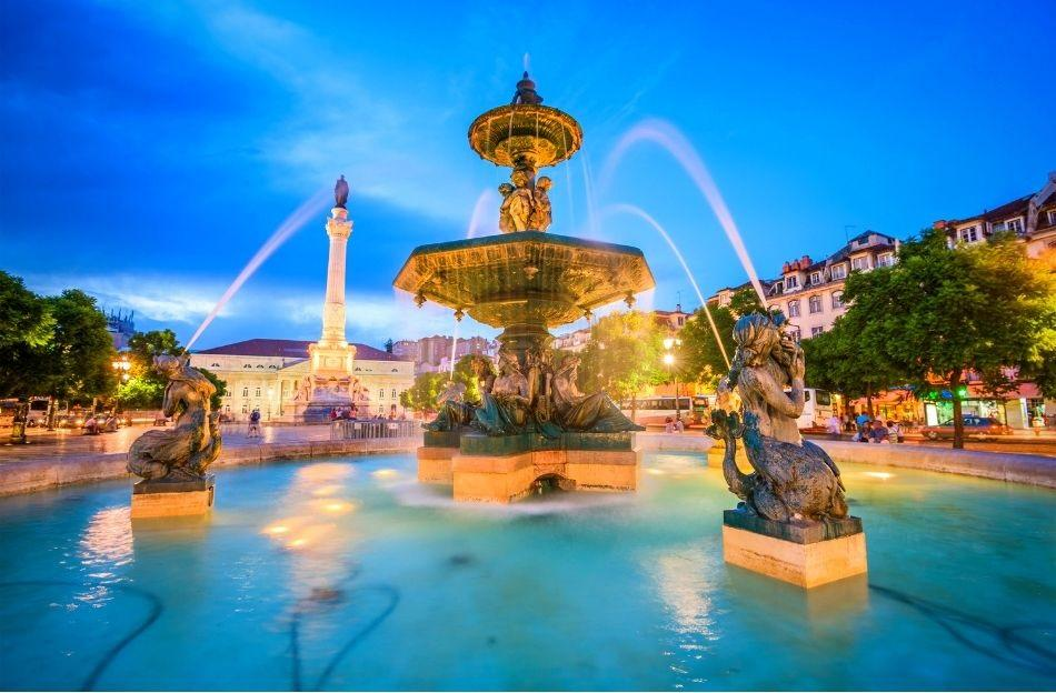 Rossio Square Lisbon during the night. The fountains are lit