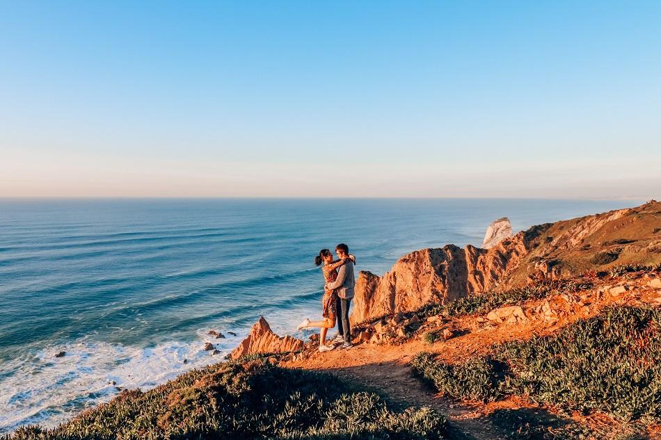 Couple hugging at Cabo da Roca at sunset, Sintra