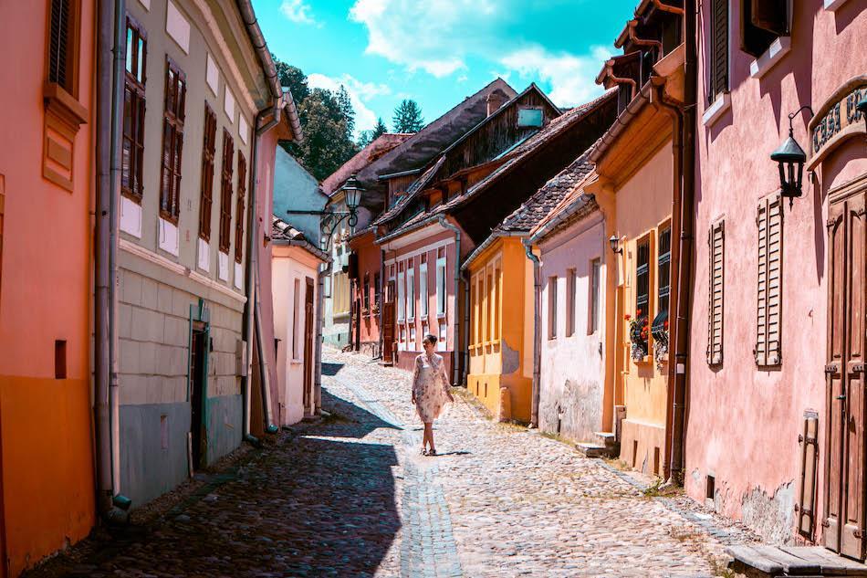 Aurelia Teslaru walking in Sighisoara Fortress Romania