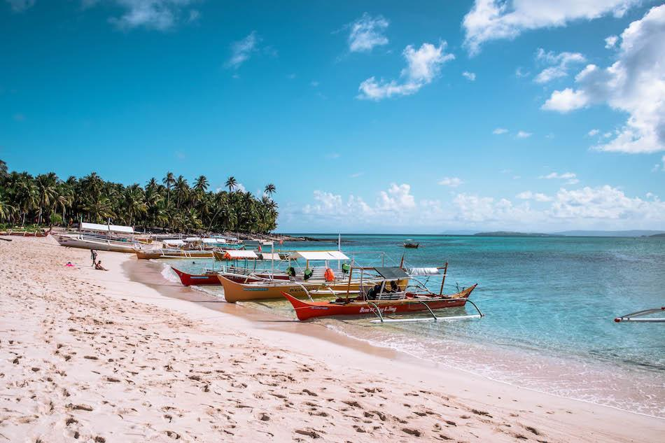Daku Island Siargao beach and boats
