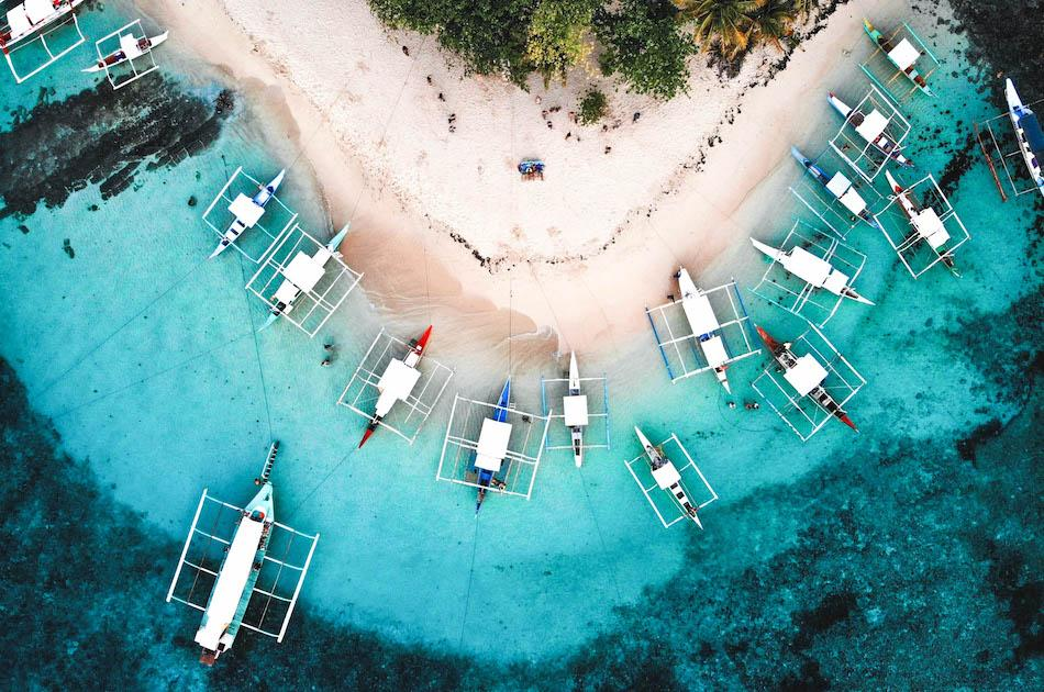 Daku Island Siargao drone photography. Boats at Daku Island Beach in Siargao