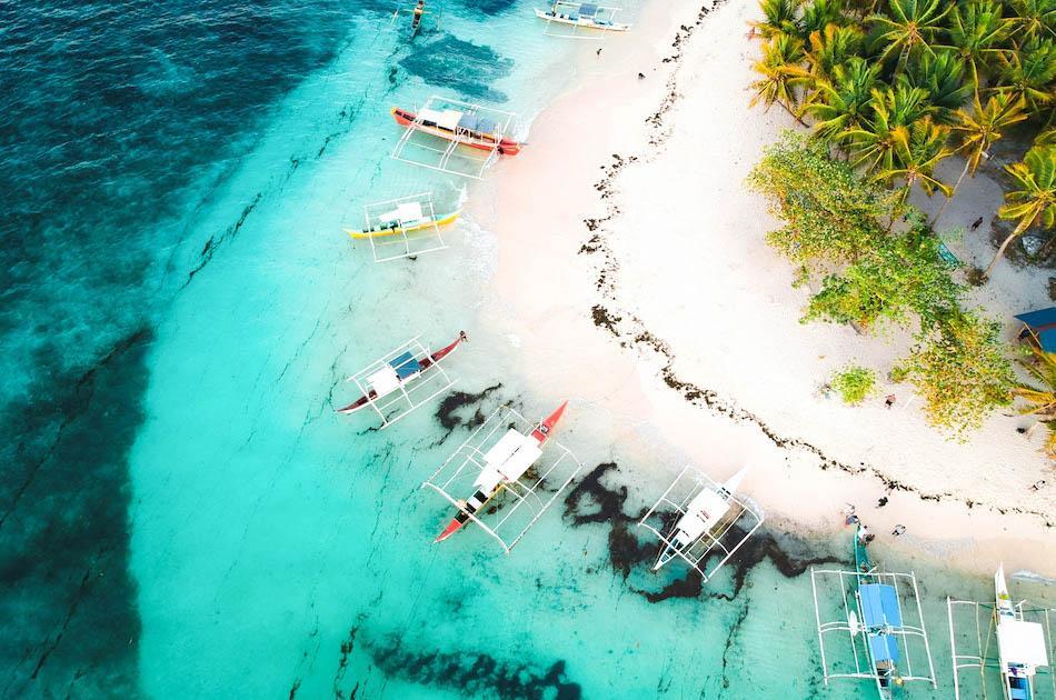 Daku Island Siargao drone photography. Boats at Daku Island Beach in Siargao