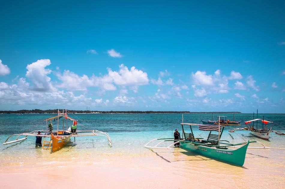 Boats at Guyam Island Siargao. Island hopping tour to Guyam Island