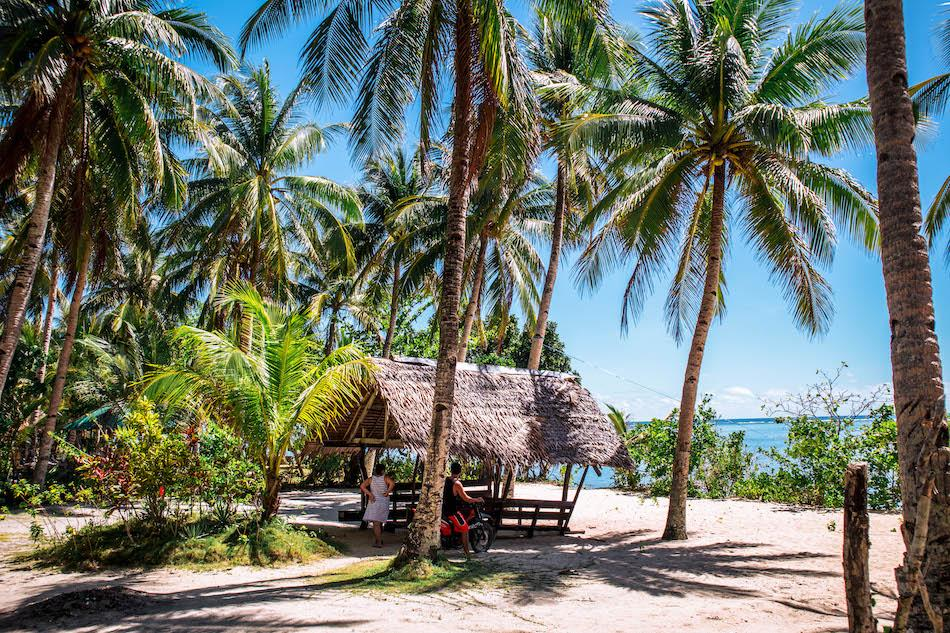 Bungalow at Pacifico Beach Siargao surrounded by palm trees