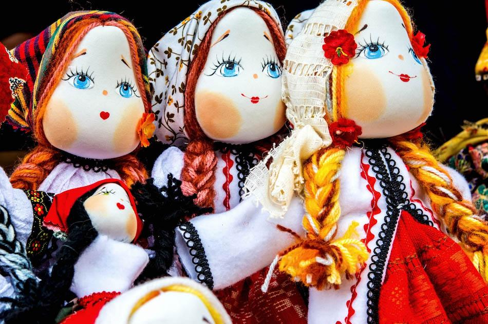 Romanian dolls dressed in traditional clothes. Romanian souvenirs, things to buy from Romania