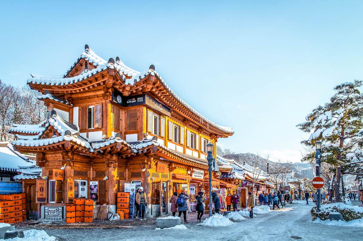 The city of Jeonju in winter. Wooden traditional gate in Jeonju in winter - things to do in Korea in Winter, winter destinations in Korea, winter activities in South Korea