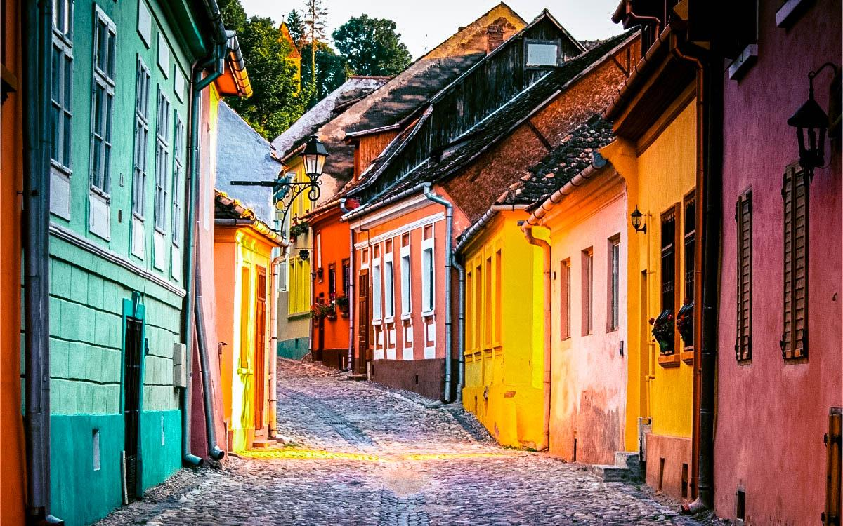 Street of Sighisoara, Romania - most colorful destinations in the world, vibrant cities, colorful cities, colorful earth, vibrant places around the world